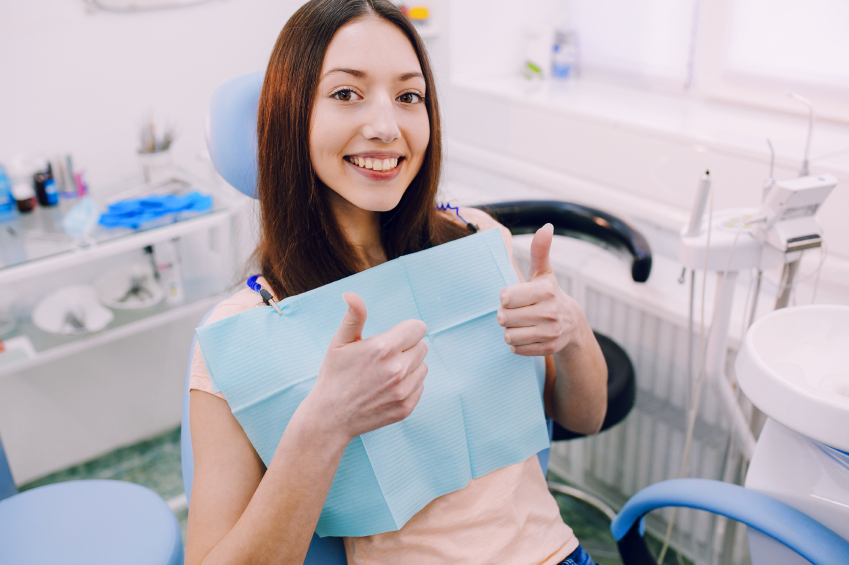 Smiling woman sitting in dental chair